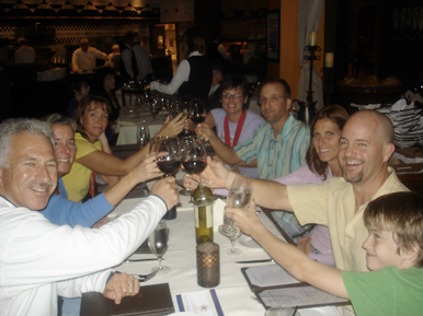 Toasting our finish with friends at the restaurant Wolfgang Puck!