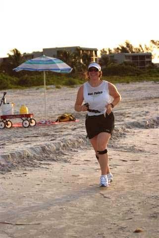 Nicole running along the beach with a smile on her face!