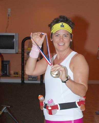 Marion displaying the finishers medals!